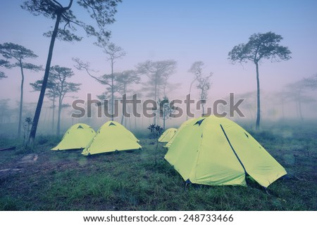 Camping Tent on hill under raining