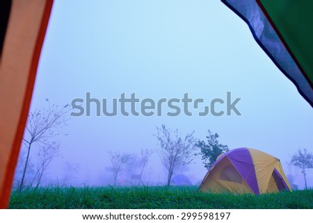 Camping Tent on hill under raining and mist