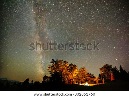 camping tent under stars at night