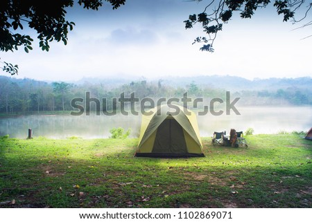 Camping tent with lake background. #1102869071