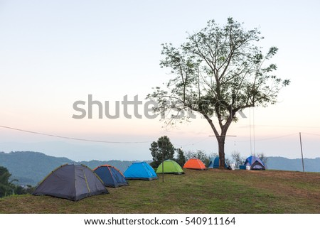 Free photos Camping tents in the mountains at Evening Time