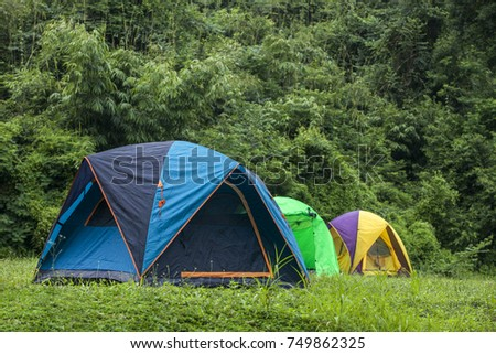 Camping tents on the lawn lake, a relaxing time with nature. thailand #749862325