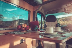 Camping Time Inside Comfortable Motorhome Interior. Stylish Self Made Camper Van Interior. Van Conversion Theme.