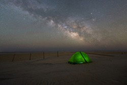 Camping under the Milky Way Galaxy and stars on a beach at Assateague Island in Maryland