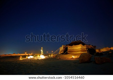 camping under the sky by the sand dune