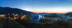 Camping under the stars at night in Carpathian mountains, motorcycle touring, dual sport enduro off road panorama