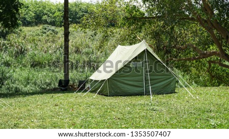 camping with canvas tent #1353507407