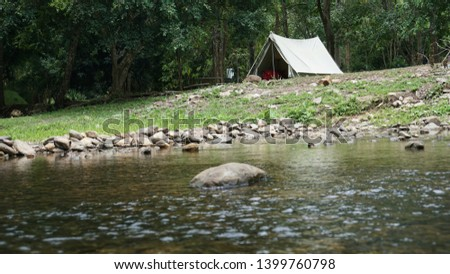 camping with old canvas tent #1399760798