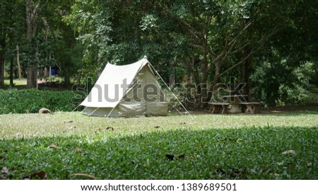 Camping with vintage canvas tent #1389689501