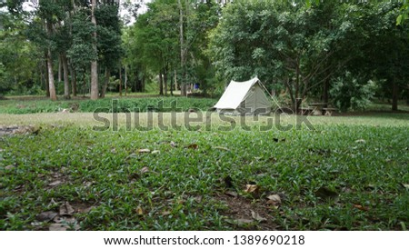 Camping with vintage canvas tent #1389690218