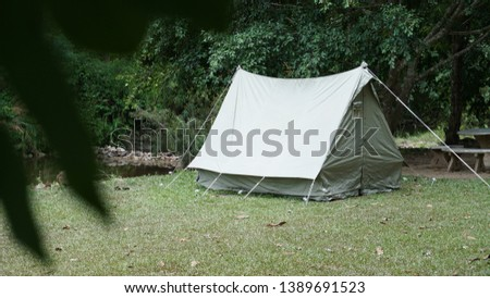 Camping with vintage canvas tent #1389691523