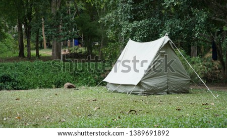 Camping with vintage canvas tent #1389691892