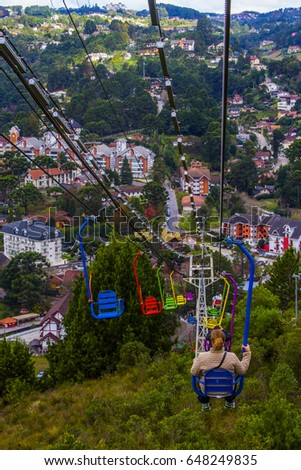 Shutterstock Campos do Jordao Sao Paulo Brazil, Teleferico cable cart chairlift riders