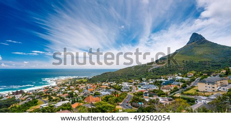 Camps Bay and Lion's Head mountain, amazing panoramic landscape of a coastal city, part of a Table Mountain National Park, Cape Town, South Africa