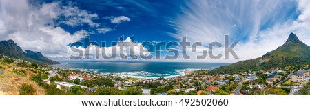 Camps Bay and Lion's Head mountain, amazing panoramic landscape of coastal city between two mountains, Cape Town, South Africa