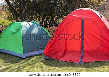 Camps on grass.