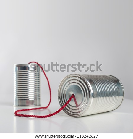 Can telephone with red wire. Conceptual communication image.