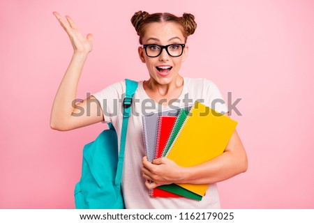 Can you imagine? Classes with a tutor were incredibly easy! Young reader girl lifts her palm up holding colored notebooks and smiling isolated on vivid pink background