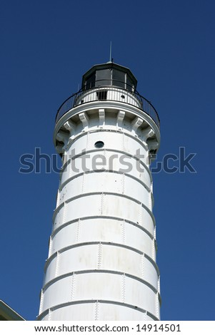Cana Island Lighthouse in Door County, WI over Blue Sky - stock photo