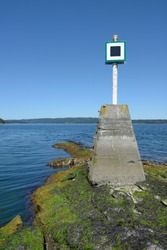 Canada, British Columbia, Island. Navigational marker on the reef at the entrance to Prates Cove