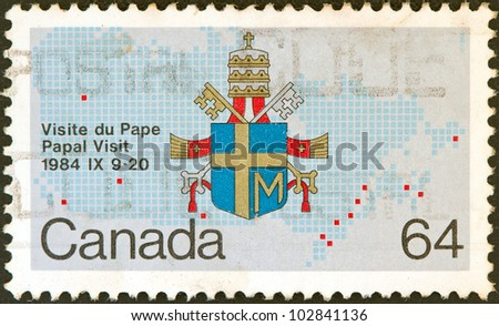 "CANADA - CIRCA 1984: A stamp printed in Canada from the ""Papal Visit"" issue shows the Coat of Arms of Pope John Paul II, circa 1984."