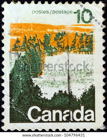 CANADA - CIRCA 1972: A stamp printed in Canada shows a forest, central Canada, circa 1972.