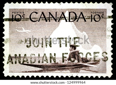 "CANADA - CIRCA 1955: A stamp printed in Canada shows Eskimo and Kayak without the inscriptions, from the series ""Canada'Â?Â?s Eskimo"", circa 1955"