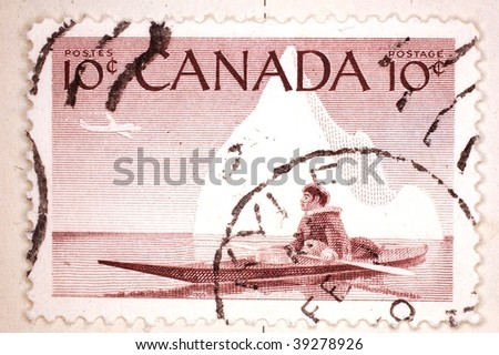 CANADA - CIRCA 1955: A stamp printed in Canada shows image of an Inuit person in a canoe, series, circa 1955