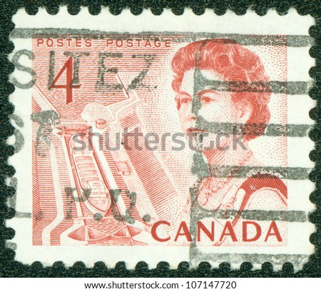 CANADA - CIRCA 1967: A stamp printed in Canada shows Queen Elizabeth II against background of locks on the river Huron, circa 1967