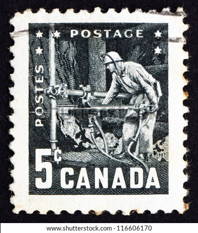 CANADA - CIRCA 1957: a stamp printed in the Canada shows Miner with Pneumatic Drill, 6th Commonwealth Mining and Metallurgical Congress, Vancouver, circa 1957