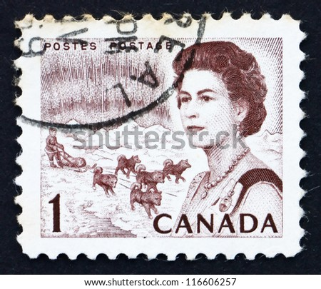 CANADA - CIRCA 1967: a stamp printed in the Canada shows Northern Lights and Dog Team, Queen Elizabeth II, circa 1967