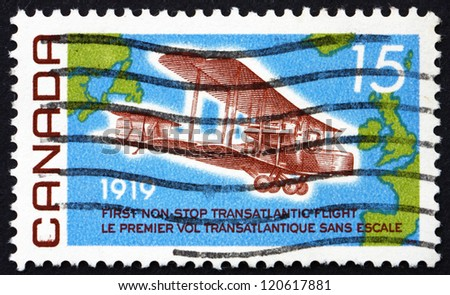 CANADA - CIRCA 1969: a stamp printed in the Canada shows Vickers Vimy, 1919, and Map of the Atlantic, 50th Anniversary of the first non-stop Flight from Newfoundland to Ireland, circa 1969