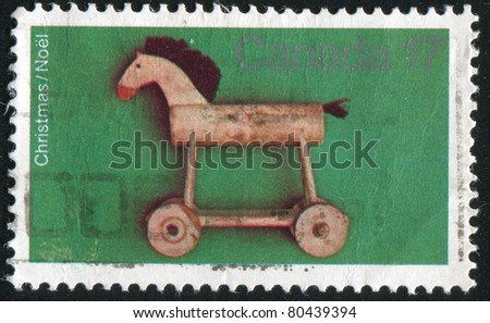 CANADA - CIRCA 1979: stamp printed by Canada, shows Horse, pull toy, circa 1979