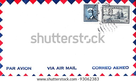 CANADA - CIRCA 1942: Stamps printed in Canada on Canadian air mail envelope shows King George VI and combine harvester with date stamp 1949, circa 1942