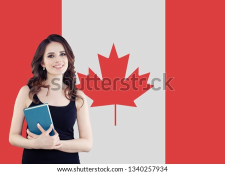 Canada concept. Young woman student with the Canada flag. Live, work, education and internship in Canada