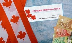 Canada doubles value of COVID 19 coronavirus stimulus economic response plan Canada flags canadian dollar bills on background
