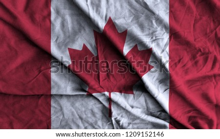 Canada Flag 3D Illustration On The Fold Fabric. Canada Flag Painting On The Fabric. 3D Rendering.