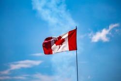 Canada Flag flying against blue sky