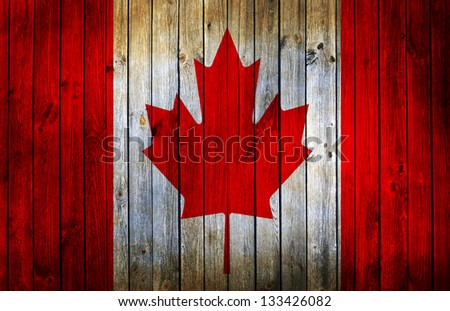 canada flag painted on old wood ...