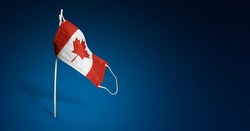 Canada mask on dark blue background. Waving flag of Canada painted on medical mask on pole. Concept of The banner of the fight against the epidemic coronavirus COVID-19. Copy space