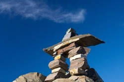 Canada, Newfoundland, St. John's. Inukshuk (to act the same way as a human). Traditional stone figure used by the Inuit to mark food, hunting grounds, or direction for travelers.