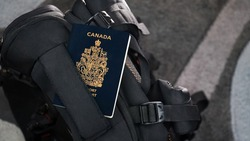 Canada Passport on a Black Suitcase Travel Bag - Canadian