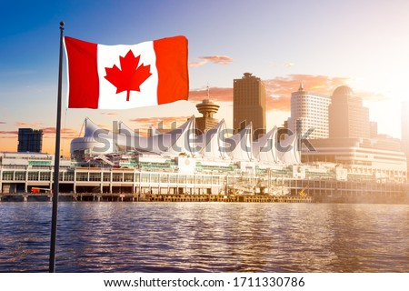 Canada Place and commercial buildings in Downtown Vancouver Viewed from water during sunset. Canadian National Flag Composite. British Columbia, Canada.