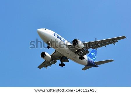 stock-photo-canada-quebec-montreal-june-air-transat-flight-taking-off-at-montreal-s-pierre-elliott-146112413.jpg