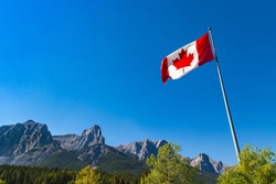 Canada's National Flag, and the Rocky Mountains. Maple Leaf represents the nations symbol the brilliant red and white are the official colors of Canada Celebrating of 150 years of confederation