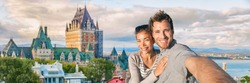 Canada summer travel tourists couple taking selfie photo at famous Quebec city landmark panoramic banner landscape. Happy young people at Frontenac Chateau, Old Quebec.