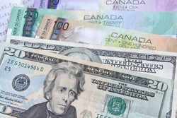 Canadian dollars vs. US dollars, which are important for board trading (manual focus)
