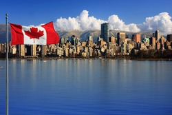 Canadian flag in front of the beautiful city of Vancouver, Canada.