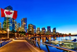 Canadian flag in front of view in Vancouver Downtown,British Columbia, Canada