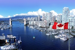 Canadian flag in front of view of False Creek and the Burrard street bridge in Vancouver, Canada.